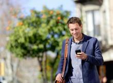 Mobile Commerce - Man using smartphone