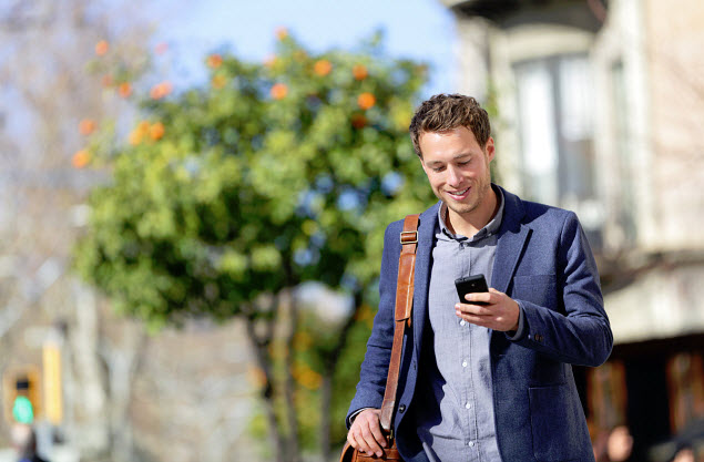 Mobile Commerce - Man using smartphone